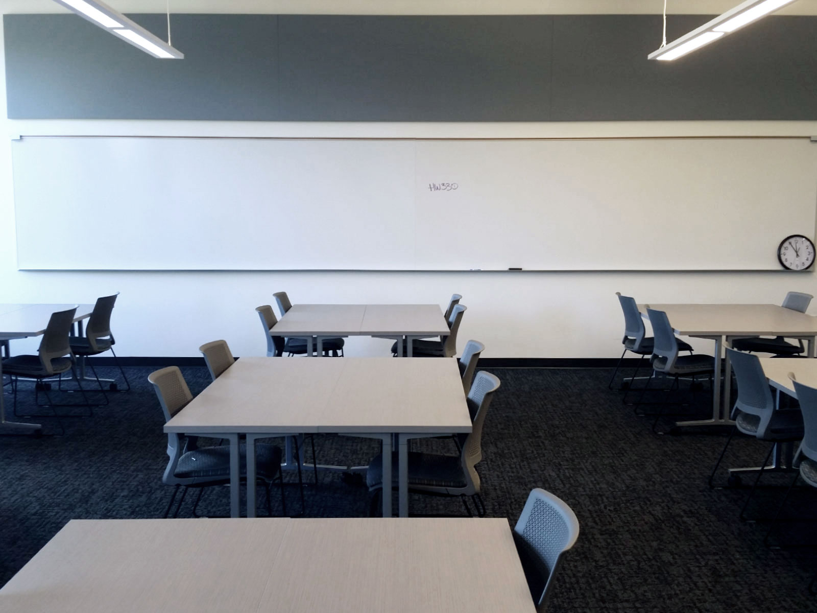 Chairs, tables and whiteboard in Harmony Campus classroom