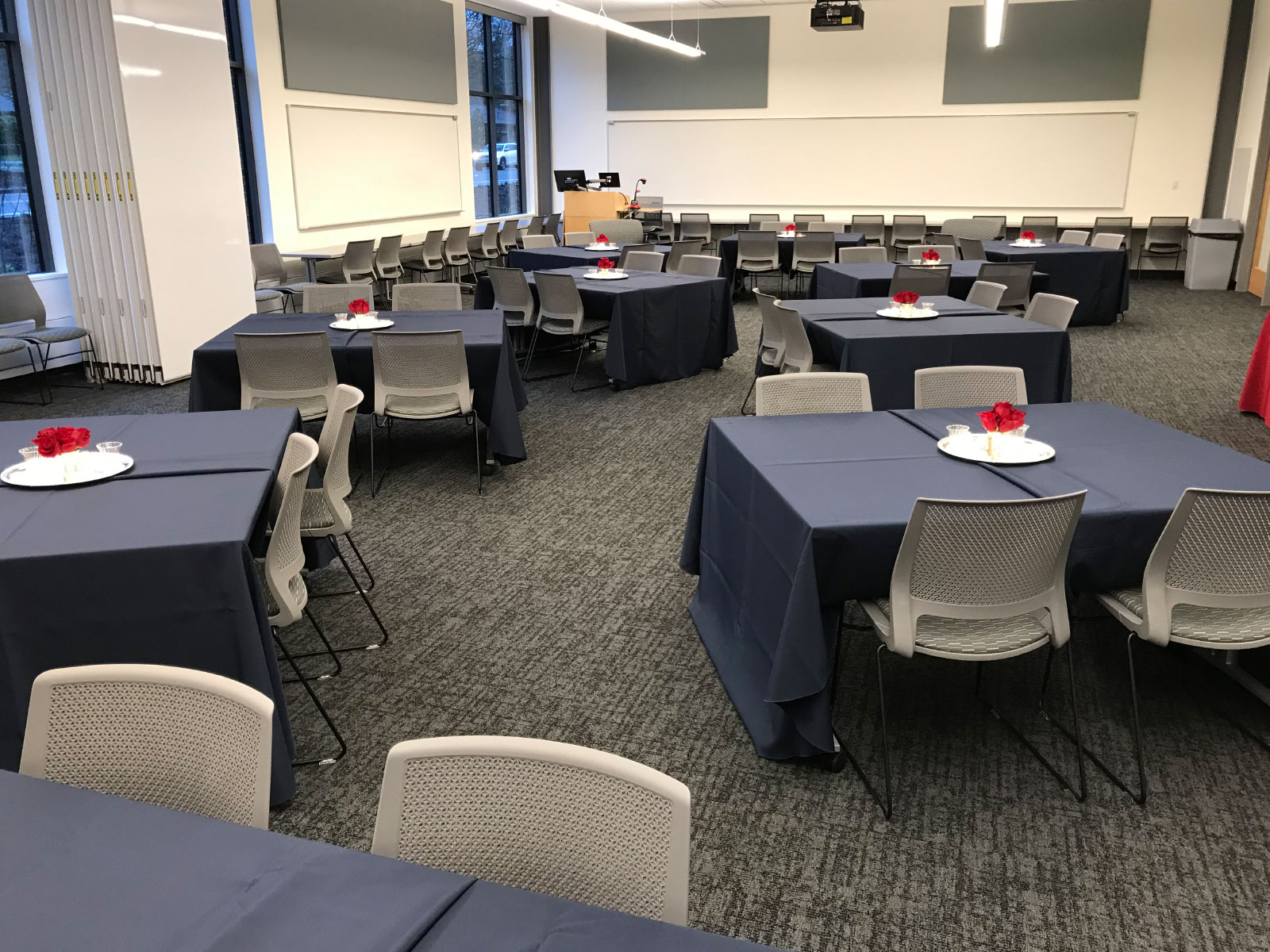 Decorated tables and centerpieces in Harmony Campus community room