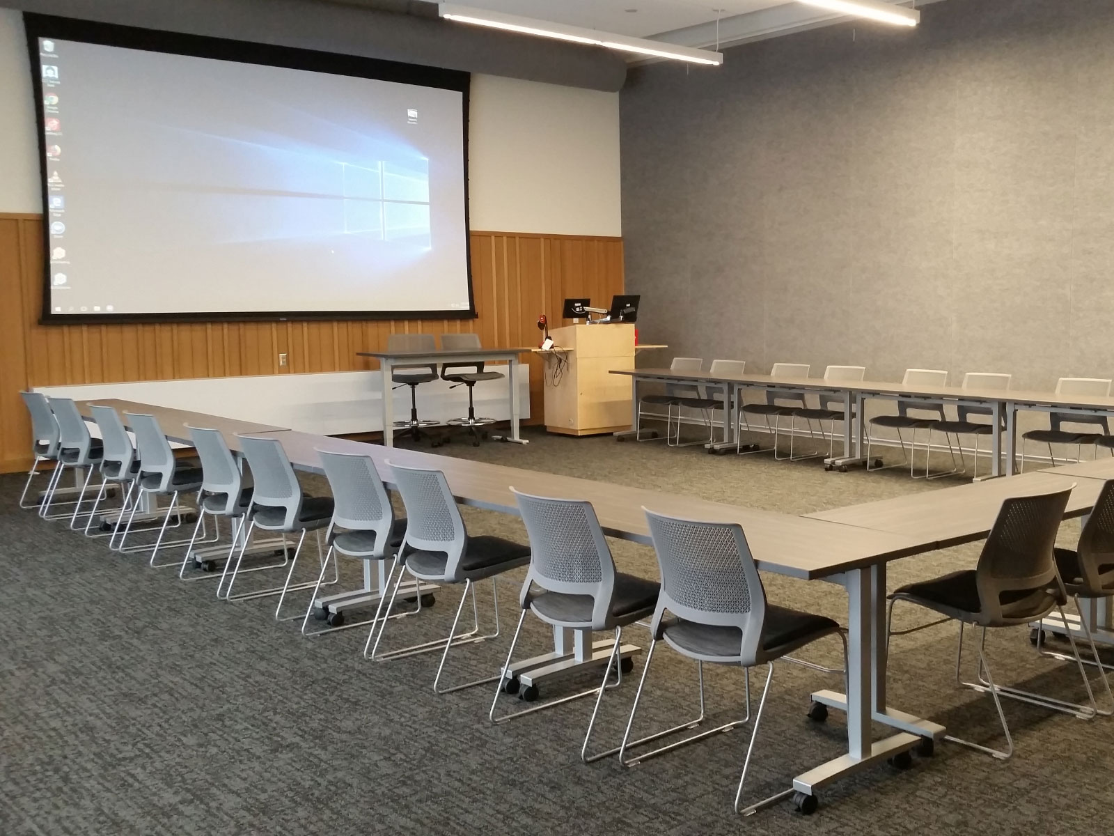 Square-shaped rows of chairs and tables in Harmony Campus community room