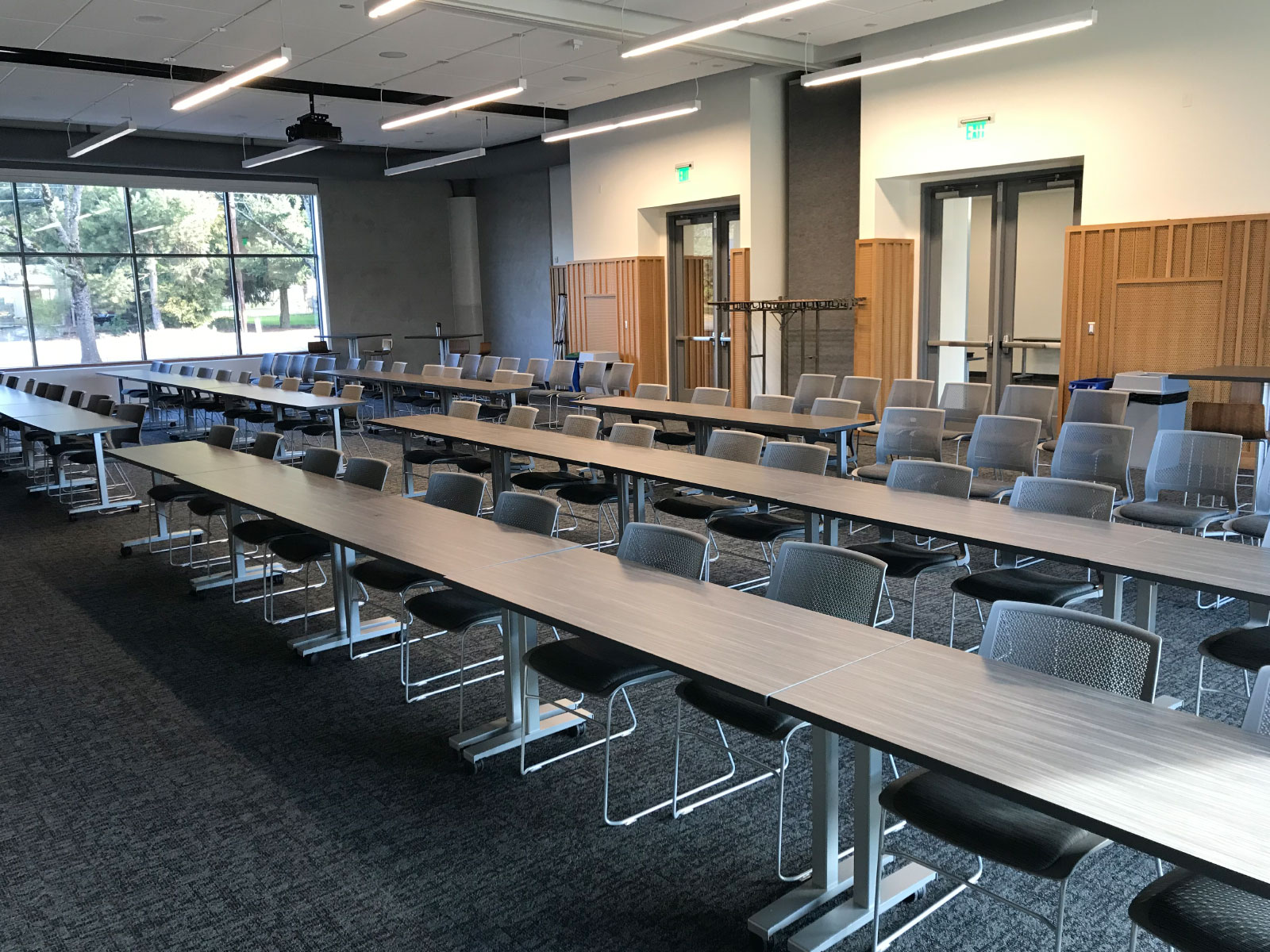 Rows of chairs and tables in a Harmony campus community room