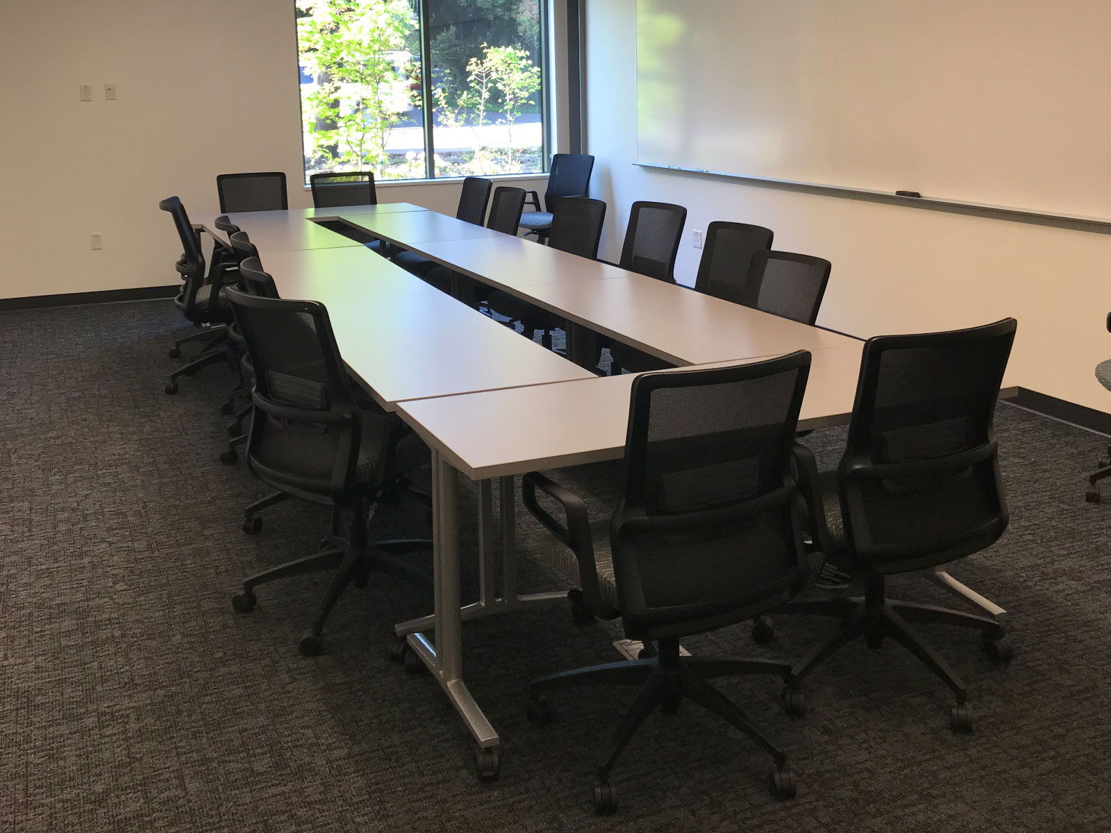 A long meeting table with many chairs in a Harmony campus conference room