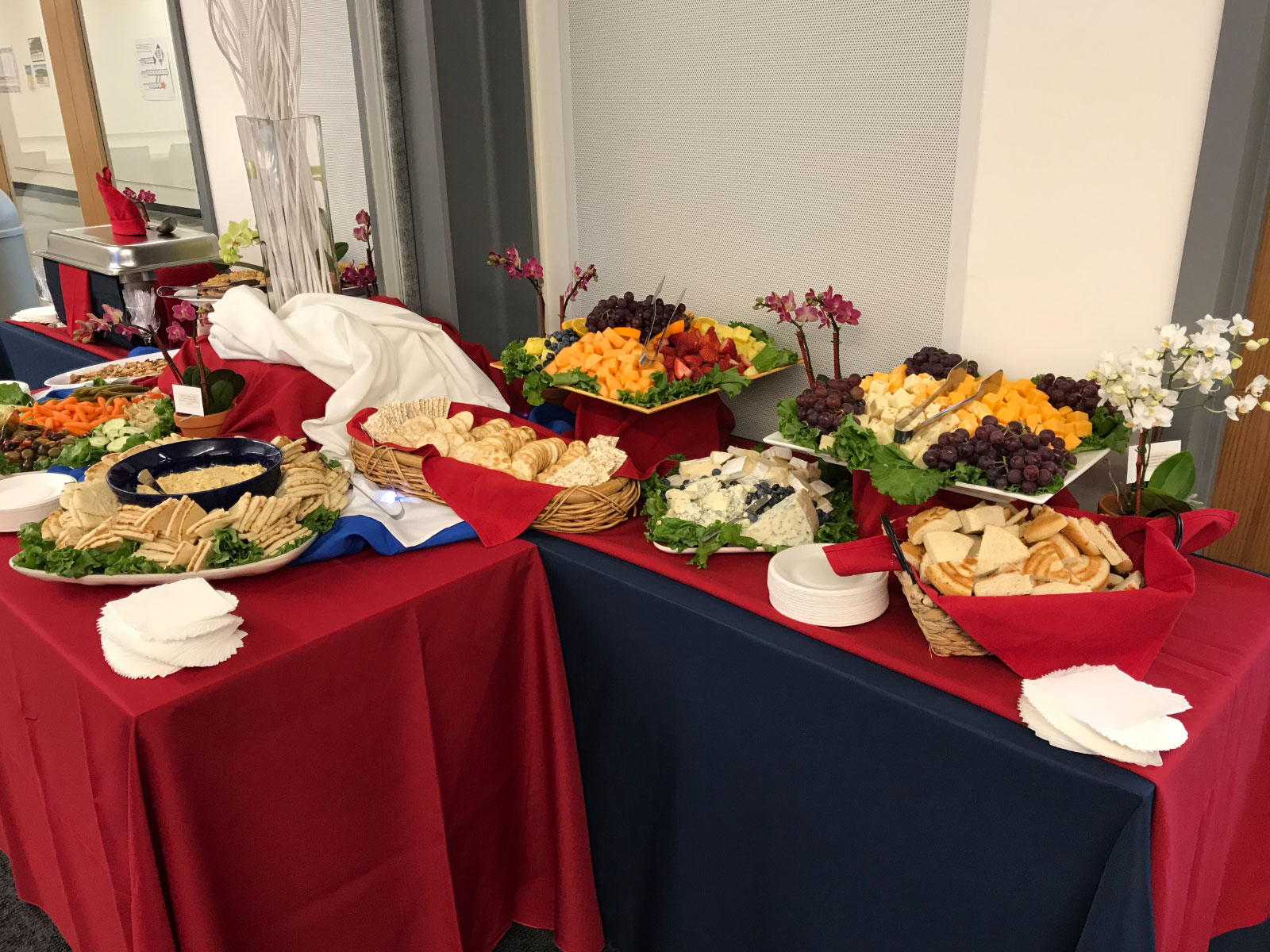 Catered food of fruit, vegetables, crackers, pita bread and dip at the Oregon City campus