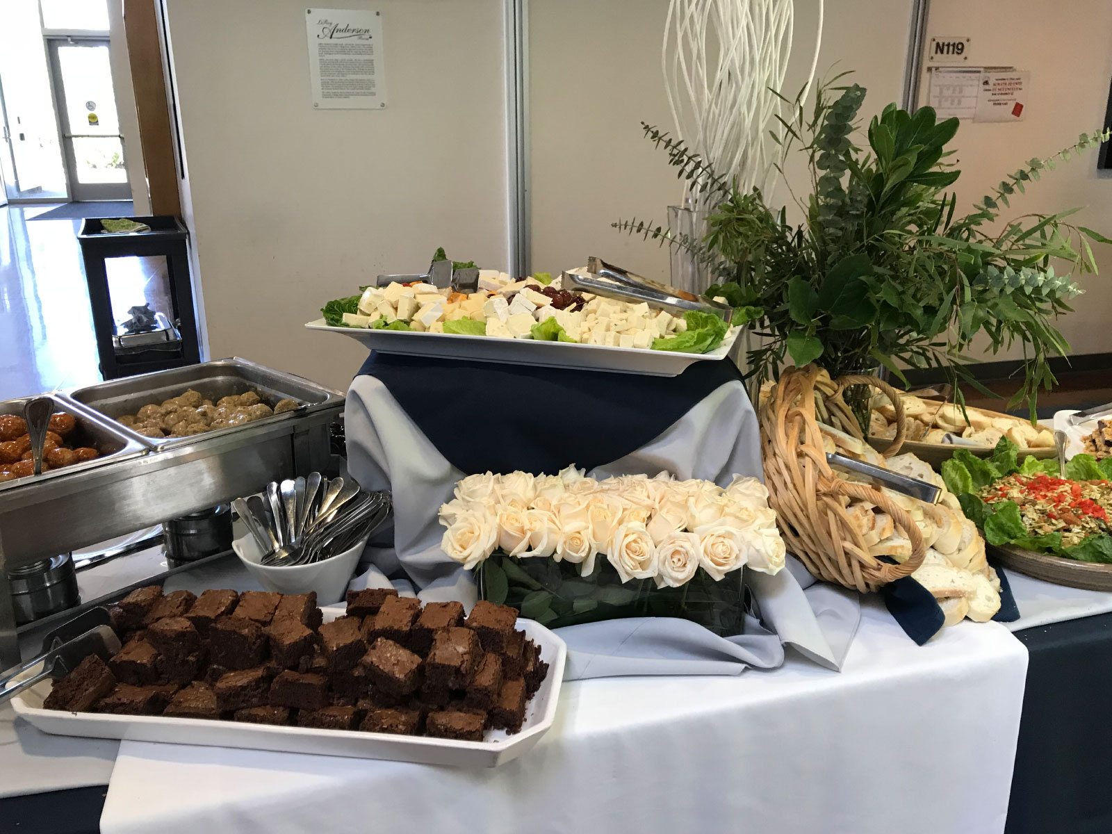 Catered food of dip, brownies, meat balls and deviled eggs at the Oregon City campus