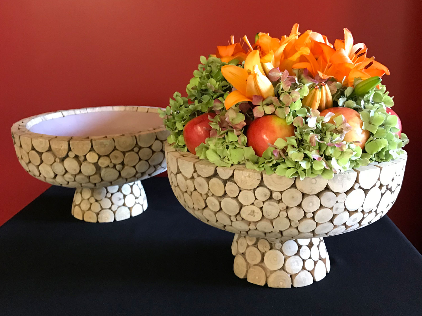 Apples, orange flowers and leaves set in a stone cradle