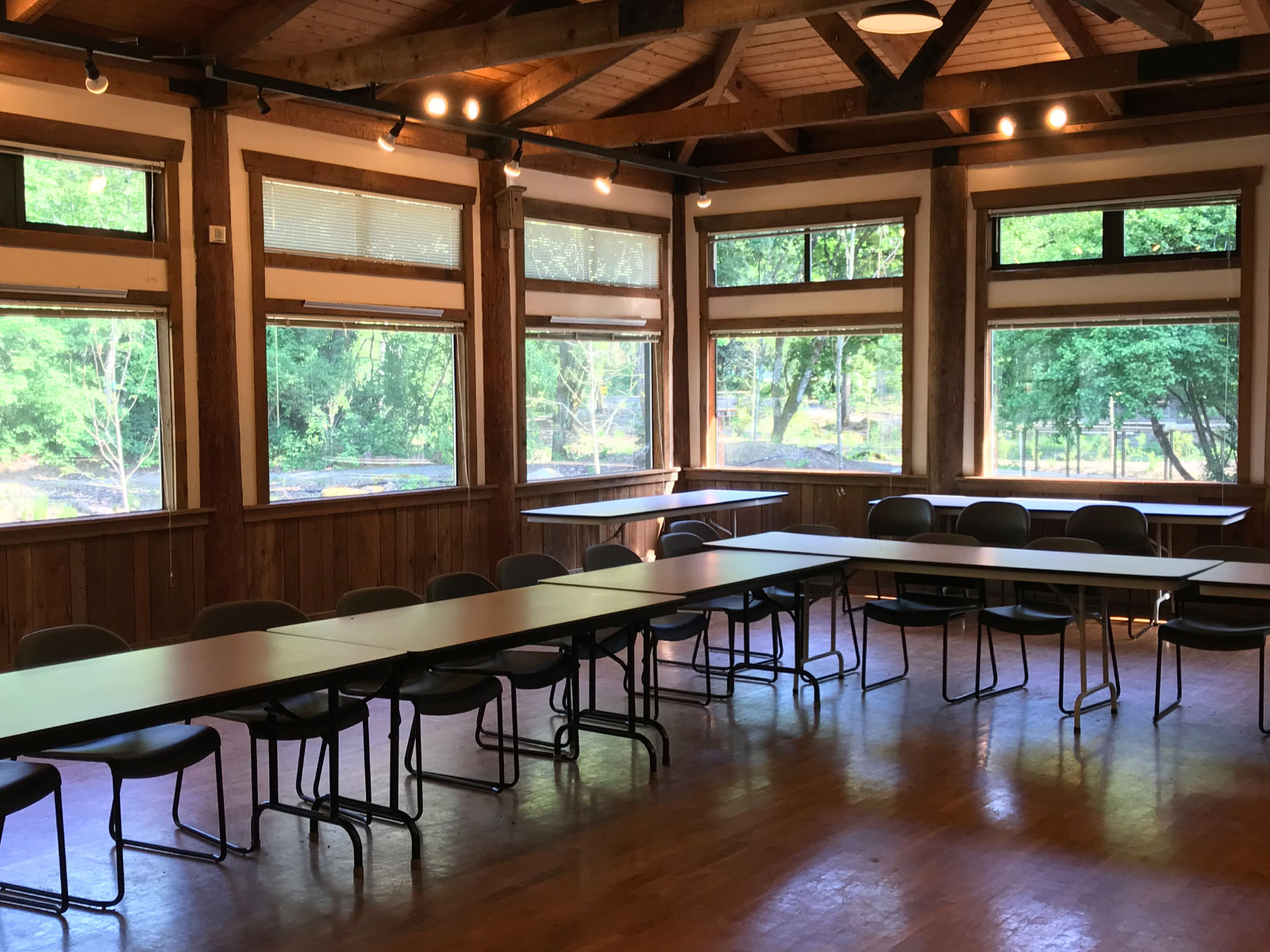 The inside of the Environmental Learning Center's Lakeside Hall, with rows of conference tables chairs