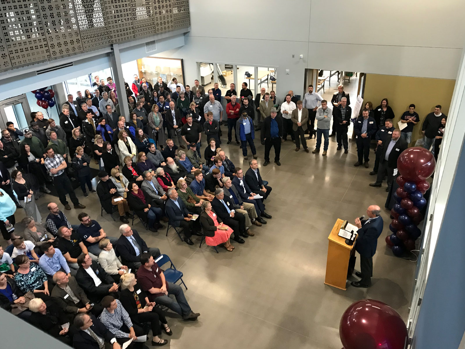 The grand opening of the Industrial Technology Center with a large audience and speakers