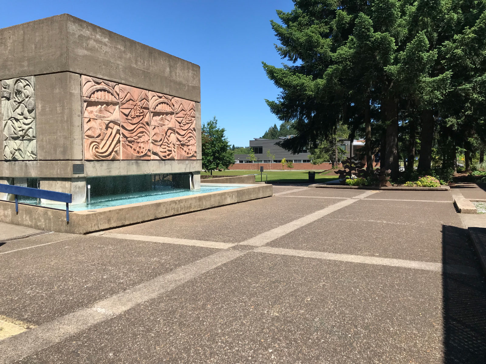 The stone structure and fountain in the quad next to Barlow Hall on the Oregon City campus