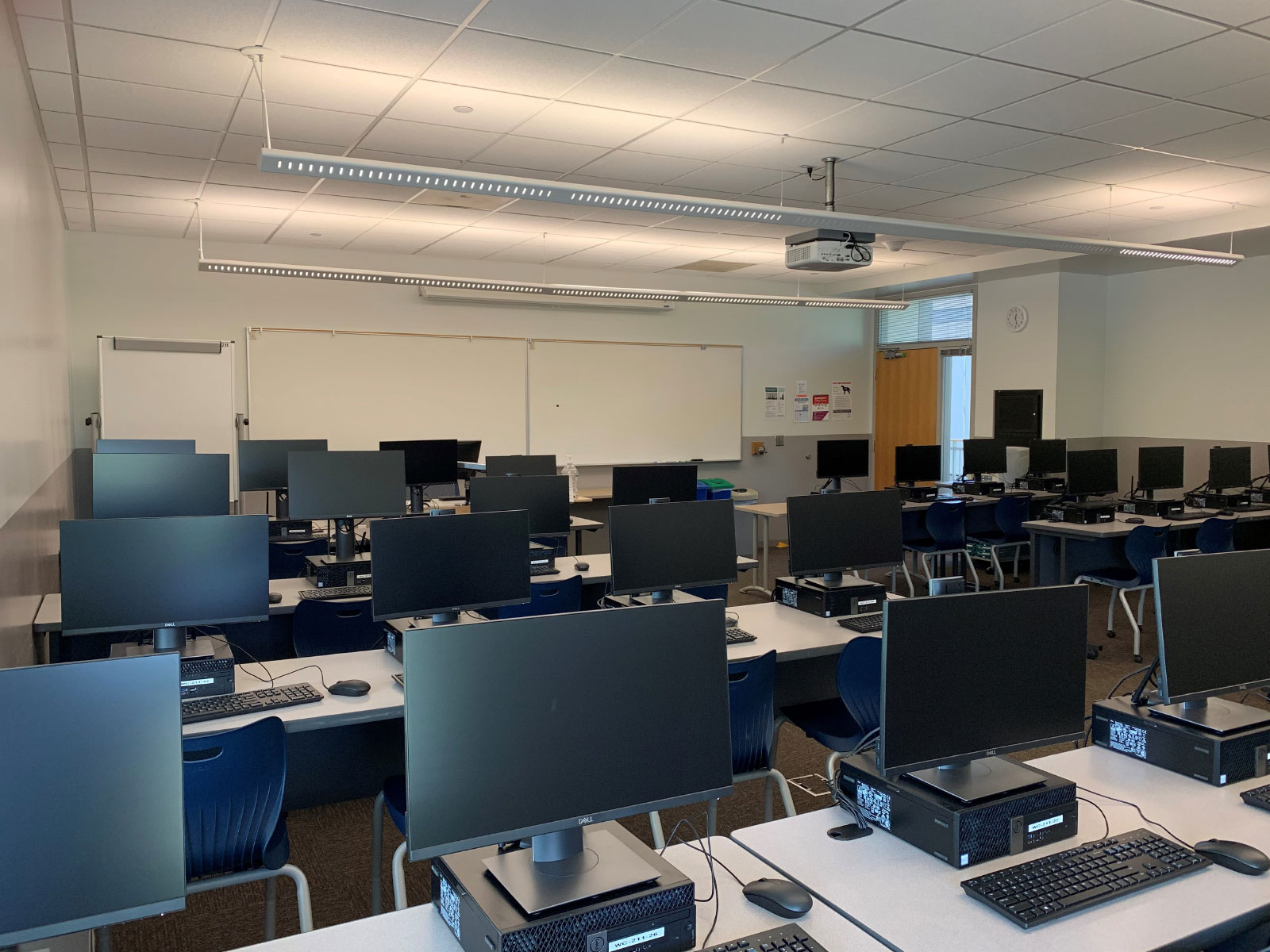 Angled close-up of rows of computers on desks in Wilsonville's Computer Lab W211