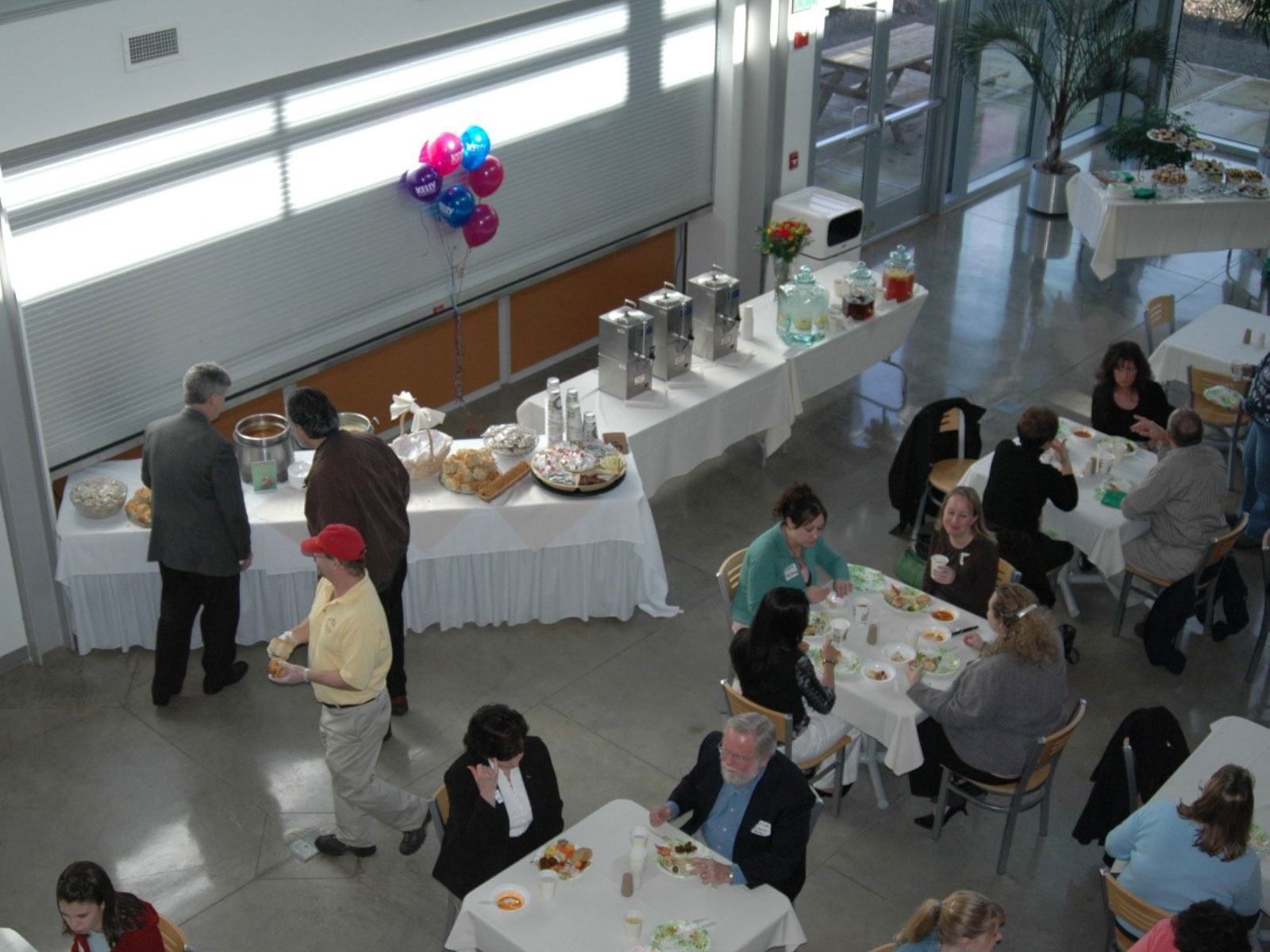 Overhead view of a catered event with various foods and drinks at the Wilsonville campus in the commons