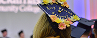 """graduating student with mortarboard that reads """"keep moving forward"""""""